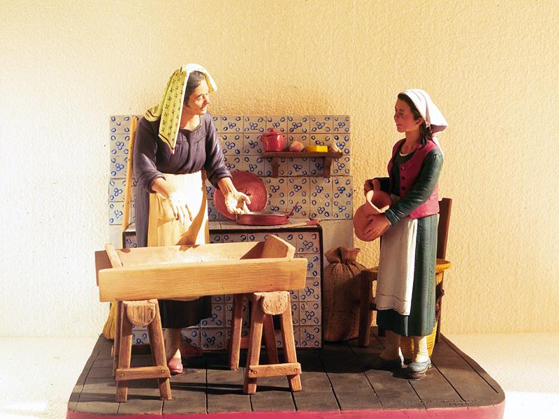 Massaie che preparano il pane